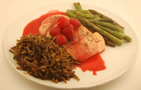 Baked Salmon on Wild Rice and Asparagus with Raspberry-Honey Sauce