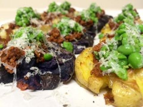 Smashed Garlic Papas with Chorizo, Manchego, and Fresh Herb Topping